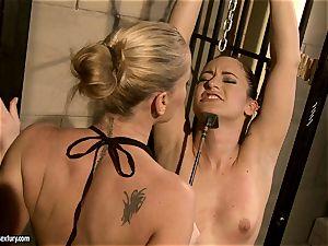 Kathia Nobili smacking a bombshell babe on the face