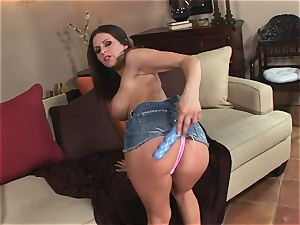 Rachel Roxx eases bare on the couch opening up her smoothly-shaven coochie