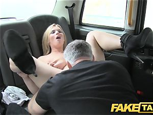 faux taxi gigantic natural orbs on platinum-blonde model