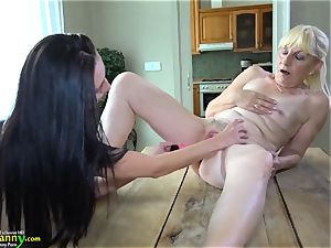 OldNanny dark haired mature shows her underpants