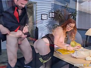 Dani Jensen playing with spear in the office