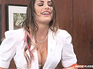 Bad black-haired August Ames juggles on trouser snake