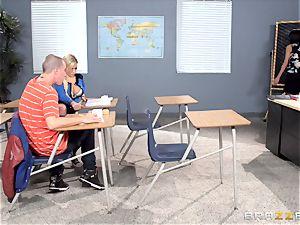 Bibi Noel and Anissa Kate poke in the classroom