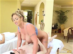 busty 50-year-old masseur Eva Notty seduces youthful dude while his girlfriend is sleeping nearby