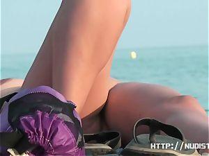 A thrilling bare beach hidden cam spy webcam vid