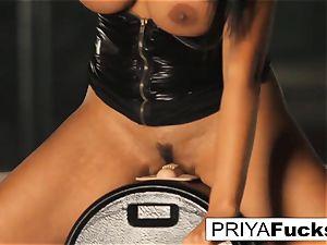 huge-titted Priya Rai rails the sybian at the de-robe club