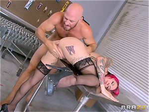 molten manager Anna Bell Peaks rides her employees pink cigar